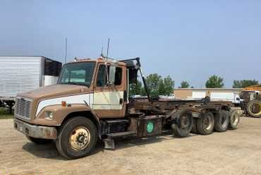1997 Freightliner FL80 Cable Roll Off Truck